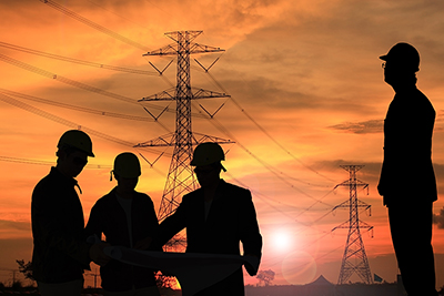 engineers standing at electricity station