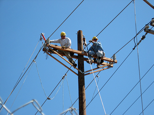 Linemen on a Poll